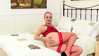 Blonde MILF Uses a Glass Dildo On Her Pussy